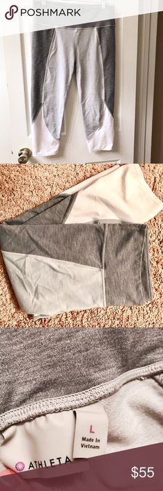 Athleta Gray Colorblock Capri Leggings Gray Colorblock Capri leggings from Athleta! In great condition they're just too big for me. (I'm not sure the exact name that athleta calls these) super soft and comfy!! Athleta Pants Capris