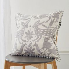 New handmade embroidered cushion on ohwhatsthis.com by our new seller, Elephant Stamp. These cushions are made in Mexico and take weeks to make! We love the pom poms!