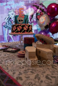 "Monster High birthday from Pixie Posie! Custom cake and coffin ""locker"" craft made with fancy duct tape, ribbons and the Skullette."