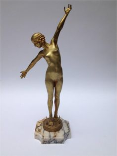 Woman Art Deco Gilt Bronze signed OUILLON CARRERE, dated 1919, on white marble base.