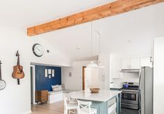 Mostly white walls, wood, and minty turquoise makes the house look cohesive. Rhodes Log before and afters of cute cottage