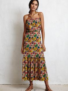 COCO DRESS FROM WARM IN SUNTAN FLORAL PRINT. Halter straps. Smocked bandeau neck. PLEATED TIERED HEM. Made in the USA Color- SUNTAN FLORAL Fabric- 100% COTTON