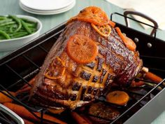 Tangerine-Glazed Easter Ham With Baby Carrots is a recipe courtesy of Tyler Florence. Looks delicious!