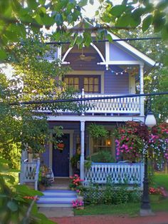 """This two-story cottage boasts three porches, and HGTV fanPeriwinklecottage says """"there is still more gingerbread to come."""" The top balcony offers a view of the village and park. An old porcelain stove on the lower front porch serves as a potting bench and storage place."""
