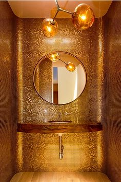 .Feel like a rockstar with a glittering golden powder room More