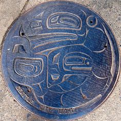 Seattle Manhole Cover VII by ManHole.ca, via Flickr Designed by Nathan Jackson.  City of Seattle 1% for art program