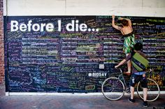 """before i die- When artist Chang was grappling with the loss of a loved one, she turned to art for comfort. The Taiwanese American artist wrote the words """"Before I die I want to _____"""" on an abandoned building in her neighborhood, allowing passersby to express their thoughts and dreams anonymously. Today over 450 """"Before I Die"""" walls live in over 60 countries, written in over 30 languages. The stunning mutual bucket list serves as a reminder of what's really important in life."""