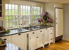Big windows, light cabinets with dark pulls