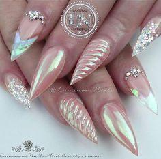 Pretty Stiletto nails with unicorn accent and glitter. Nail art design ideas