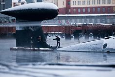 The tail fin of possibly a Russian Sierra class or Akula class submarine