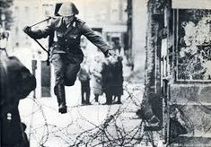 """""""The Jump to Freedom""""—an iconic image from the Cold War. Construction of the Berlin Wall began on this day in Peter Leibing [East German soldier jumping barbed wire barricade to freedom as he defects from East Berlin], 1961 West Berlin, Berlin Wall, 1 John, Unusual Facts, Old Photography, East Germany, Interesting History, Cold War, World History"""