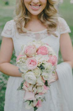 Cascading rose bouquet: http://www.stylemepretty.com/australia-weddings/2014/06/11/classic-vintage-chic-wedding-at-montsalvat/   Photography: Luma Photo - http://luma-wedding-photography.com.au/