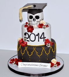 Graduation Cake With Hand Sculpted Sugar Skull and Flowers by Desserts By Rondi