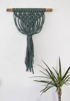 This modern macrame wall hanging was hand knotted on a natural oak stick from cotton jersey yarn. This small piece of wall art is a perfect decoration for the Boho, Natural, Scandinavian, Woodland, Urban Jungle, Minimalistic Neutral Pastel interiors. Details:  ★ Size: Width-35 cm/14 inches , Length-47 cm/18,5 inches. ★ It is totally made by hands.  ★ It is made from recycled cotton jersey yarn and natural oak stick   Real colors may slightly differ from their appearance on your dis...