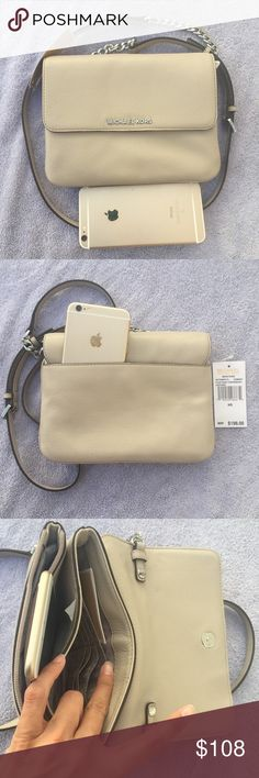 Brand new Michael Kors crossbody leather wallet Brand new with tag. Never used. Never worn. In a perfect condition. Has 3 division inside . And the back pocket will fit an iPhone 6 plus easily. Size is 8.5 x6.5x2. The long strap is adjustable and detachable. The color is cement on the tag. Tag price is $198. The price is firm. Please don't waste your time bargaining. 100% cow leather . Will ship fast and ship it in a box. Michael Kors Bags Wallets