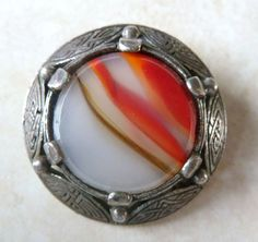 Vintage Celtic style shield brooch with faux agate center by British designer Miracle.
