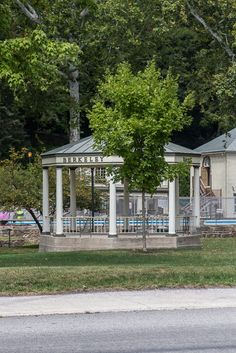 A gazebo sits on the Berkeley Springs State Park grounds. The old Roman bath house is in the background. These grounds have been the catalyst for growth in the town over its entire lifetime.