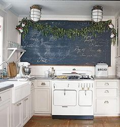 That Amazing blackboard-I need more space in my kitchen  Farmhouse sink, amazing stove!  Why oh why do I love white cabinets so much, they wouldn't last 1 min. in my house!