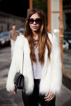 Beautiful Snow White faux fur jacket. Team with leather shoulder bag and oversized sunglasses.