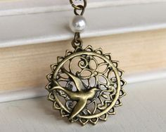 SALE The Hunger Games  Mockingjay necklace by Sevinoma on Etsy, $0.99 @Lynsey Spence district 13