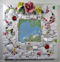 Snowy Spring mirror of antique china shards, flowers, and small shiny red accents. - By Mosaic Artist Melissa Miller
