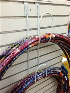 With millions of Hula Hoops® sold since their invention in I am surprised that this is the only Hula Hoop Hook for Endcap Display I have ever seen Slat Wall, Hula Hoop, Display Shelves, Clothes Hanger, Hooks, Families, Twin, Retail, Yellow