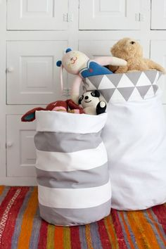 I've got toys and stuffed animals a-plenty. I've got blankets and pillows galore. You want bouncy balls? I've got twenty! So I figured it's time to make more cute storage solutions for corralling all