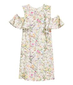 Natural white/floral. Short dress in soft, woven viscose fabric with a printed pattern. Opening at back of neck with button and short, ruffled sleeves with