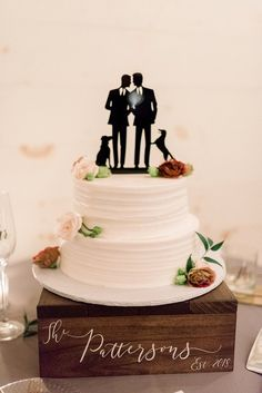 Simply textured two tiered white wedding cake with gay wedding cake topper of two grooms and their two dogs sitting on a wooden cake box stand #weddingcake #caketopper #gaywedding #caketoppers #gayweddings #lgbtqweddings #cakestand #doglovers #cake #weddingideas #wedding Gay Wedding Cakes, Wedding Cake Toppers, Tuxedo Colors, Wooden Cake, Reception Design, Wedding Cake Inspiration, Box Cake, Pretty Cakes, Something Blue