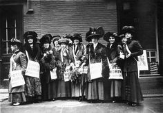 Members of the women's suffrage movement prepare to march on New York's Wall Street in armed with leaflets and slogans demanding the vote for women.
