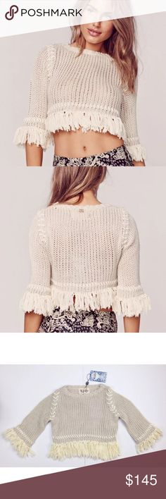 """NWT XS & Medium For Love and Lemons Denver Crop Brand New With Tags For Love & Lemons """"Denver Knit"""" Crop Sweater Size: X-Small & Medium Gorgeous creamcolored crochet crop top. Fringe along the wrists and the hem line. Crochet body is see-through. Material is stretchy. This top has a slightoversized fit to it. Material Content: 100% Acrylic For Love and Lemons Sweaters Crew & Scoop Necks"""