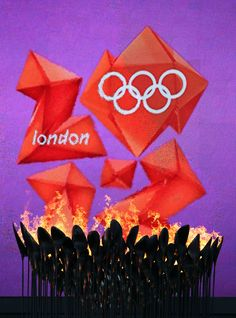 The Olympic Cauldron burns in front of the London 2012 logo.  Photo by: Streeter Lecka/Getty Images