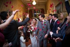 Bride and Groom confetti shot at Horsted Place wedding