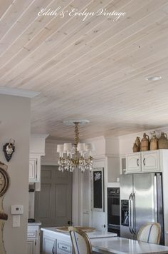 Planked ceiling in kitchen with pickling stain.