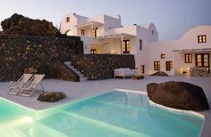 Poolside at Aenaon Villas in serene Santorini .