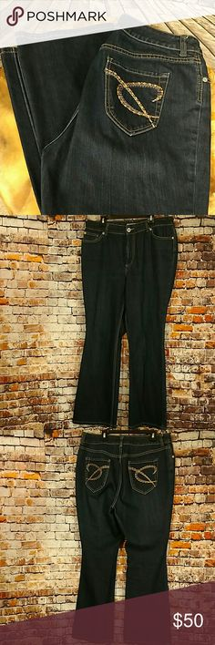 NWOT Chico's Denim Jeans Dark denim Chico's jeans with embroidery and Brass stud accented back pockets. Chico's size 2 Short,  equals large or size 12. 15 1/2 inch across waist lying flat, 11 inch rise, 28 1/2 inch length. Charm Jean sits at the natural waist and has a relaxed hip and thigh. Classic straight leg. Zipper fly. 5-pockets. Imported. 98% cotton, 2% spandex. Chico's Jeans Straight Leg