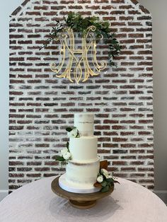 Make that wedding cake floral pop with your monogram hanging behind! Contact us today!