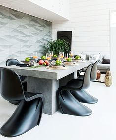 Vernor Panton Chairs and concrete table...gorgeous!