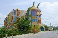 Mollusk Mojo Although construction proceeded at a snail's pace (it took 10 years to build), this colorful five-story house in Sofia, Bulgaria, was finally completed in 2009 by its contractor/owner. It's built with lightweight concrete on a wire frame, and we'll assume it complies with all regulations — a reminder to always check your local building codes before beginning any project of your own.