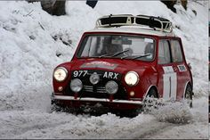 Peter Barker and Willy Cave plow through very slushy conditions on their way from St Etienne to Gap in their ex-Works Morris Mini Cooper.