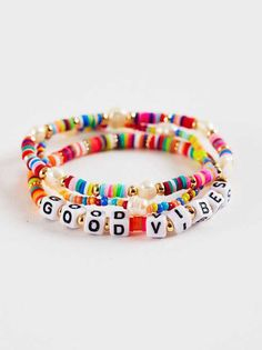 "Shop Good Vibrations Bracelet Set at Altar'd State. This fun and vibrant set of 3 bracelets features multi colored tiles and letter blocks that say ""Good Vibes"" to keep the mood positive wherever life takes you! Letter Bead Bracelets, Letter Beads, Beaded Bracelets, Arm Candy Bracelets, Bracelet Crafts, Bracelet Set, Bracelet Making, Jewelry Making, Summer Bracelets"