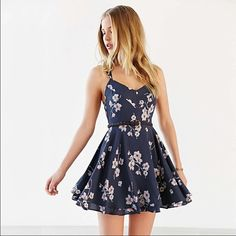 """LAST ONE gorgeous backless flower print dress Gorgeous blue dress with flower print. Somewhat Backless since straps are thin and have a cute criss cross design. Mad out of polyester materials. MEASUREMENTS: SMALL: waist: 27.5"""" length: 31.2"""" MEDIUM:  waist: 29"""" length: 31.8"""" LARGE: waist: 30.7"""" length: 32.4"""" Dresses Mini"""