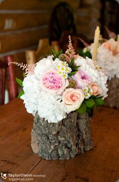 stump with flowers..with darker blooms and dark moss maybe, make it look more wintery?