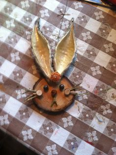 Natural ornament bunny.  Got some wood circles and narrow milkweed pods? Go for it!