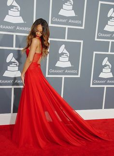 Love that dress... I thought the carpet was part of it for a second!!!<3