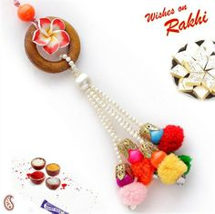 Wood and Wool Lumba Rakhi with colourful Hangings Pom Pom Crafts, Flower Crafts, Send Rakhi To India, Rakhi Design, Rakhi Gifts, Drawing Skills, Picture On Wood, Online Gifts, Jewelry Patterns