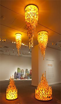 Chemical Balance III, by Jean Shin, 2009. Prescription bottles, mirror and epoxy, fluorescent lights. 5 units, from 18 to 40 inches in diameter. Overall dimensions variable. Installation at Smithsonian American Art Museum, Washington, D.C.