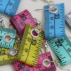 tape measure earrings, how creative is that?!! i would like it better as a keychain