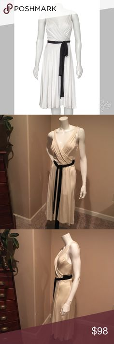 Diane von Furstenberg 4 silky viscose wrap dress Diane von Furstenberg 4 silky viscose wrap dress. Beautiful cream and black slinky wrap dress. Super comfortable and easy to wear. Measurements will be posted soon. Diane Von Furstenberg Dresses Midi