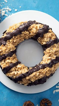 Recipe with video instructions: Resistance is futile, don't even try. Ingredients: 1 box dark chocolate brownie mix, 8 Samoas, 4 cups large flake shredded unsweetened coconut, 3 cups caramel...
